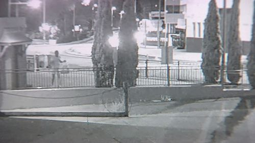 Police are now trying to track down a man they want to speak to who can been seen on CCTV jumping a fence into a carpark, before changing clothes and leaving again.