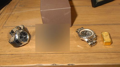 Luxury watches and gold bullion.