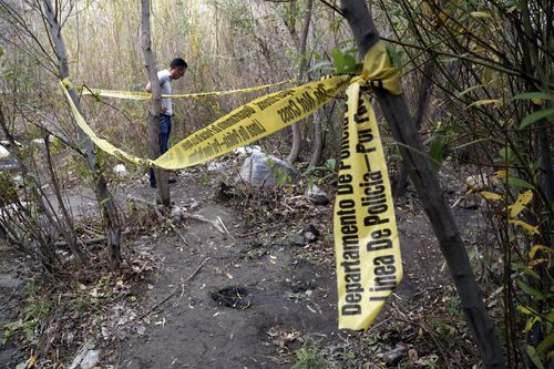 """A person stands near the spot where Mark Salling, who played Noah """"Puck"""" Puckerman in the hit musical-comedy """"Glee,"""" was found dead in a remote area of Big Tujunga Canyon in the Sunland-Tujunga area of Los Angeles. (AAP)"""