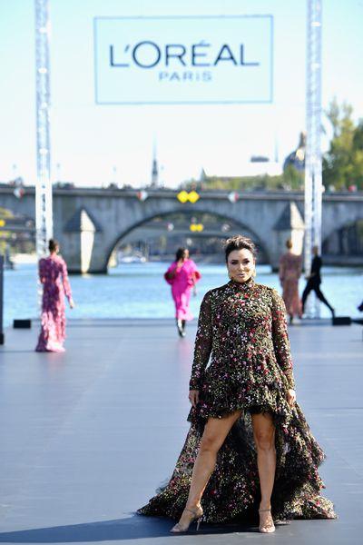 Eva Longoria walks the runway for the L'Oreal Paris fashion show during PFW
