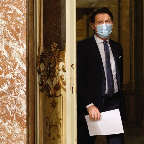 Italian Premier Giuseppe Conte arrives for a press conference at Palazzo Chigi in Rome, Italy, Friday, Dec. 18, 2020