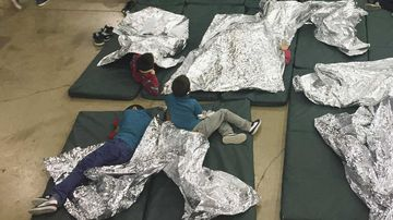 Children sleep on the concrete floor of a immigration detention facility.