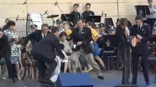 Ian Kiernan was among a group of men who tackled David Kang to the stage floor. Prince Charles (right) watches on.