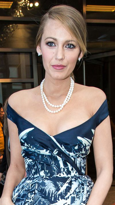 A perfect lady in pearls and a chignon.
