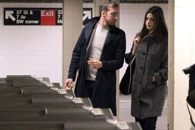 The love train rolls on for these two! Actress Anne Hathaway and hubby Adam Shulman were caught kissing on the subway in NYC.