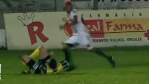 Footballer William Ribeiro attacks the referee.