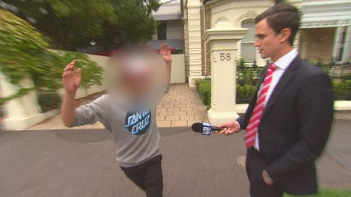 The boy today lashed out at 9NEWS on the streets of North Adelaide, after he was released on bail. (9NEWS)