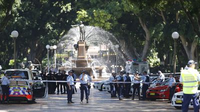 Police officers close off Hyde Park in Sydney's CBD. (AAP)