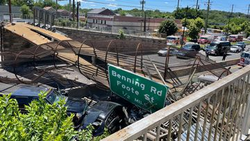 Pedestrian bridge collapses onto DC highway, injuring several people