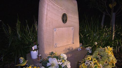 A plaque from the memorial was found on the ground. (9NEWS)