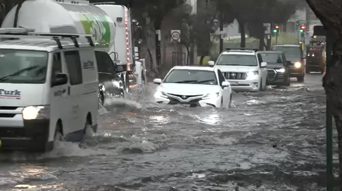 Traffic in Mascot, Sydney was brought to a near standstill as cars slowly waded through flooded streets.