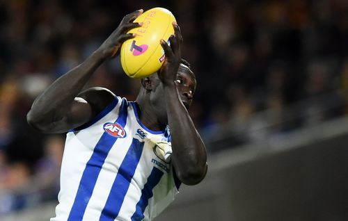 But as tensions simmered between police, the public and many African youth, the AFL's first Sudanese-born player knew he had to step in. (AAP)