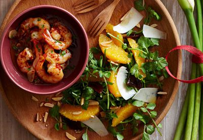 Garlic prawns with orange and watercress salad plate