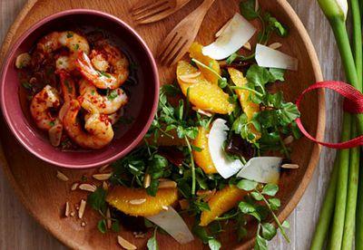 Garlic prawns with orange and watercress salad plate