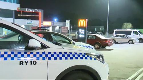 A 20-year-old man was taken to hospital with facial injuries after allegedly being attacked with a baseball bat in a brawl outside a Sydney McDonald's this morning. Picture: 9NEWS.