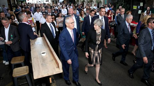 Malcolm Turnbull and Theresa May at the Borough Markets where Australians were embroiled in a terror attack on June 3. (AAP)