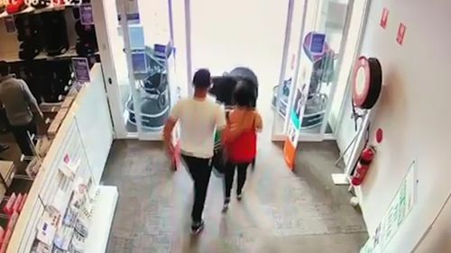 The pair walk calmly out of the store pushing the pram. Picture: Facebook
