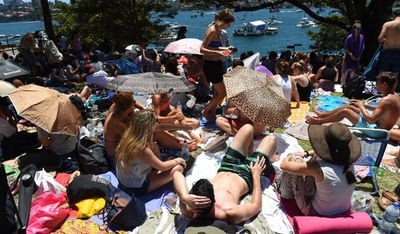 Crowds descended on the popular fireworks vantage point of Mrs Macquarie's Chair. (Getty)