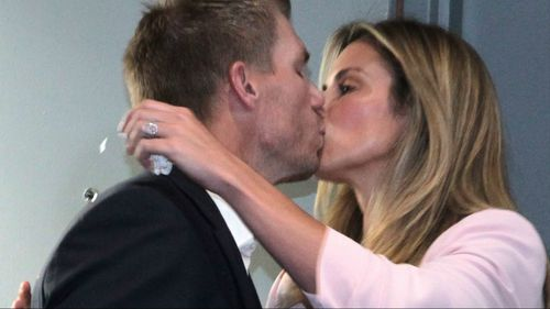 Warner kisses his wife before the press conference began. (9NEWS)
