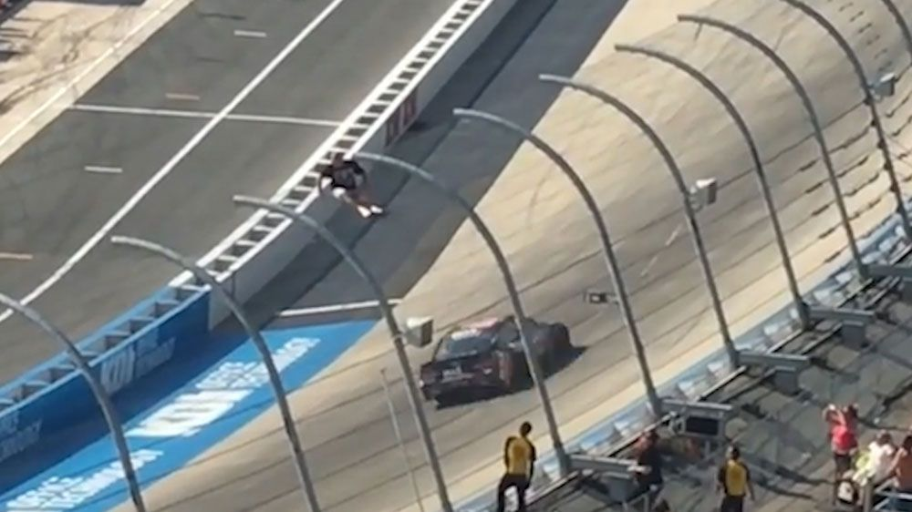 NASCAR fan risks his life to get closer to the action