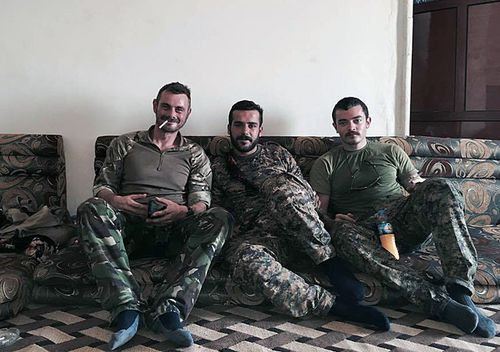 Queensland man Ashley Dyball (right), also known as Mitchell Scott, pictured with the YPG who are battling Islamic State in Syria. (AAP)