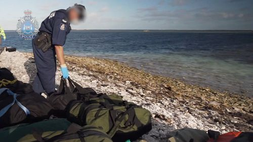 About one tonne of illicit drugs has been found on a West Australian island after a yacht ran aground on a reef.