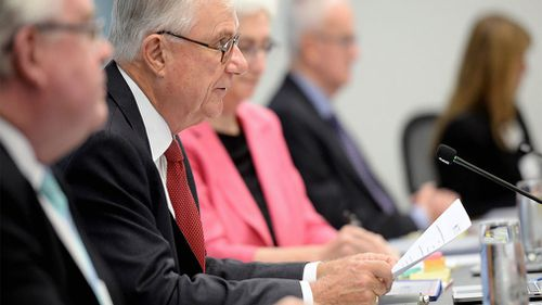 Justice Peter McClellan AM (second left) addressing the public hearing into the nature, cause and impact of sexual abuse (Case Study 57) during the Royal Commission into Institutional Responses to Child Sexual Abuse in Sydney. (Image: AAP)