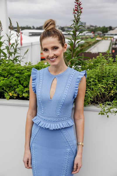 Kate Waterhouse wore her hair in a funky high knot. But her dress? A classic cut in corn flower blue.