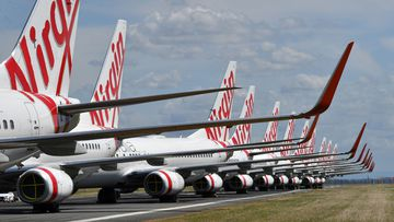Virgin Australia jets sit idly.