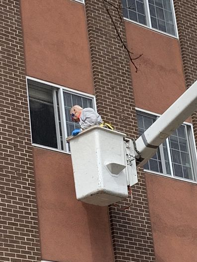Nick was launched into the air to see his wife on a cherry picker with the help of his son Chris.