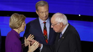 Tom Steyer finds himself awkwardly in the middle of Elizabeth Warren and Bernie Sanders post-debate.
