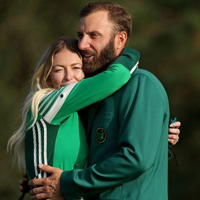 Paulina Gretzky and Dustin Johnson hug after the Masters 2020 final round.