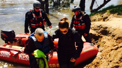 The man and his dog were eventually rescued from a tree near the Yarrawonga Holiday Park. (9NEWS)