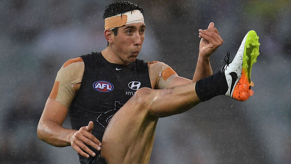 Carlton Blues show true grit in upset AFL win over Essendon Bombers
