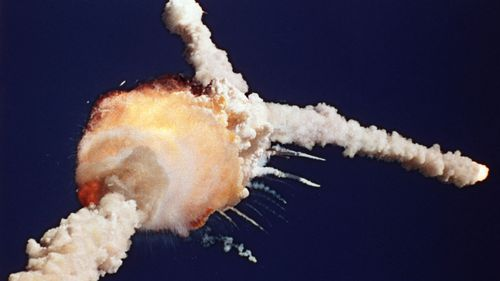 Challenger space shuttle explodes.