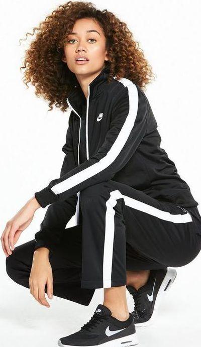 """<a href=""""http://www.very.co.uk/nike-sportswear-tracksuit-blacknbsp/1600224677.prd"""" target=""""_blank"""">Nike Sportswear Tracksuit top</a>, $96.78 and <a href=""""http://www.very.co.uk/nike-sportswear-polyknit-pant-blackwhitenbsp/1600224646.prd?crossSellType=item_page.recs_1"""" target=""""_blank"""">Sportswear Polyknit Pant</a>, $73.91<br /> <br />"""