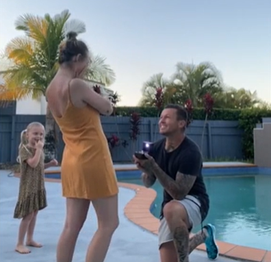 Todd Carney proposes to his girlfriend Susie Bradley.