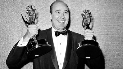 "In this May 26, 1963 file photo, Carl Reiner shows holds two Emmy statuettes presented to him as best comedy writer for the ""Dick Van Dyke Show,"" during the annual Emmy Awards presentation in Los Angeles."