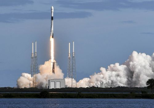 A SpaceX Falcon 9 rocket lifts off from Cape Canaveral Air Force Station carrying 60 Starlink satellites. The Starlink constellation will eventually consist of thousands of satellites designed to provide world wide high-speed internet service.