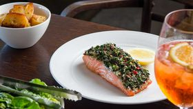 Oven baked ocean trout with tahini and soft herb salad