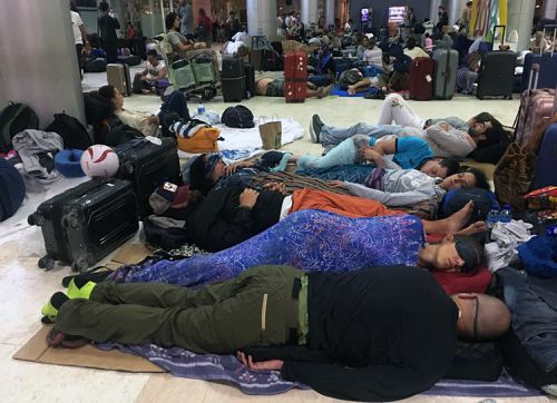It is believed it could take up to four days for tourists, who are currently choking up Lombok Airport, to be able to fly out. Picture: AAP.