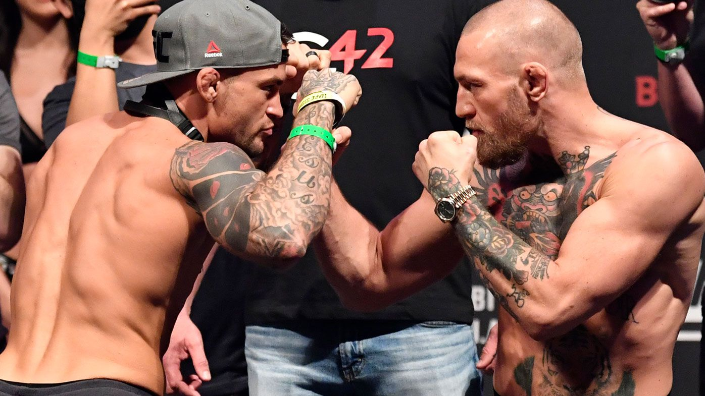 Conor McGregor and Dustin Poirier face-off ahead of UFC 257. (Getty)