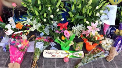A memorial has been set up at the Adelaide Oval with flowers and messages of support for Phillip Hughes. (Adelaide Oval)