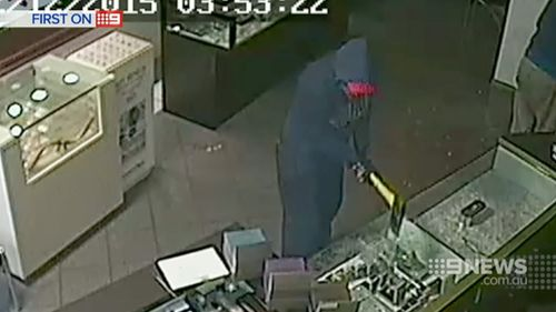 The pair broke in and smashed through glass cases before fleeing with the jewellery. (9NEWS)