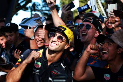 <p>Ricciardo takes a selfie with fans outside Albert Park on the Friday of the Grand Prix. (AAP)</p>