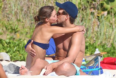 Olivia Palermo got cuddly with boyfriend Johannes Huebl at the beach in St Barts.