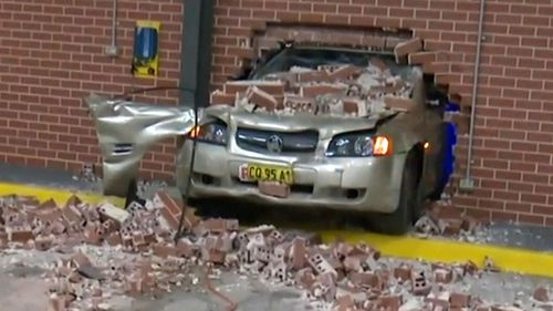 The woman drove through a wall of an ambulance station after losing control of her car in a hospital carpark.