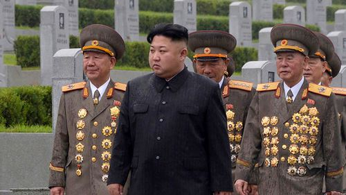 North Korean leader Kim Jong-Un (C) visiting the Fatherland Liberation War Martyrs Cemetery in Pyongyang. (AFP)