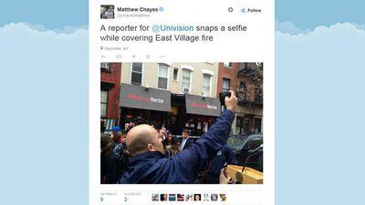 Journalist Mathew Chayse snaps a Univision reporter taking a selfie. (Twitter: @chayesmatthew)