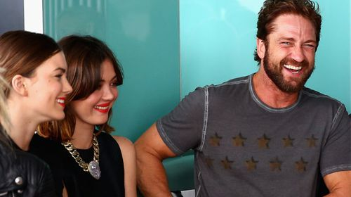 Gerard Butler front-row at a fashion event during his time filming Down Under. (Getty)